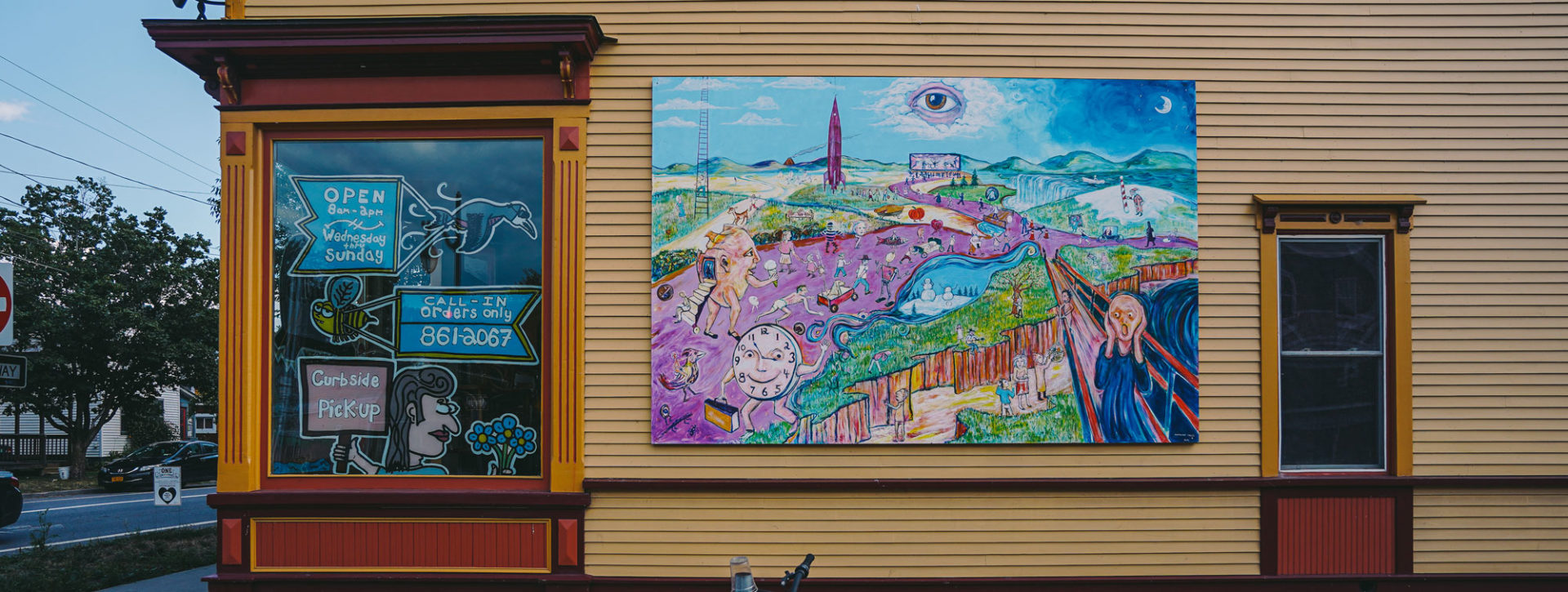 Aerial image and video courtesy of William Daugherty - storefront with brightly colored painting
